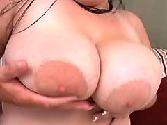 Busty plumper sucks cock