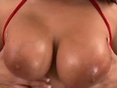 Busty slut caresses tits