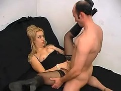 Beautiful blond girl in leather boots fucks on bed