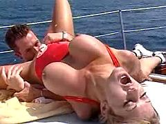 Busty blonde gets fucked on boat