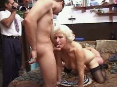 Granny does blowjob and gets licking pussy in orgy