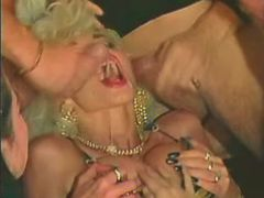 Blonde milf gets cumshot in mouth after swing orgy
