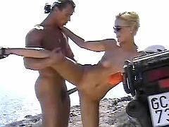 Blond slutty fucks on the sea shore