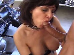 Brunette mature gives fantastic blowjob in garage