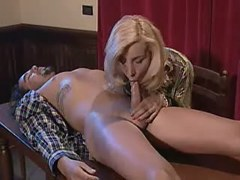 Blond shemale sucking tattooed hunk right on table