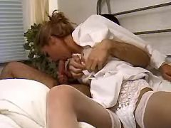 Horny nurse sucking cock