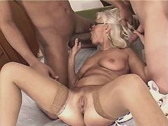 Blonde aged mature sucks two big cocks in gangbang