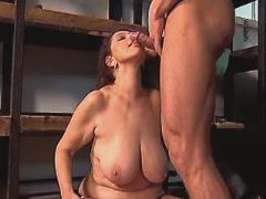 Hot mature with flabby tits sucks cock in workshop